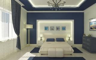 Двушка с синей кухней и красной кроватью в спальне